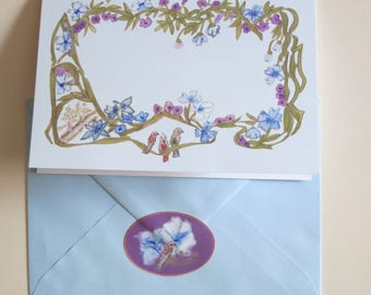 Flower tendrils with birds and light blue envelope and label DIN A5