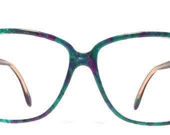 Vintage eyewear. Made in Italy 1980's. Blues and purple colors. Excellent quality and condition! Mod Urban 80's style.