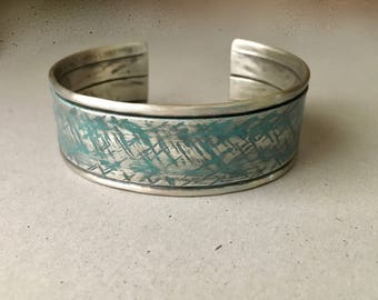 Rustic silver cuff, cross hatch textures, folded design, turquoise ink