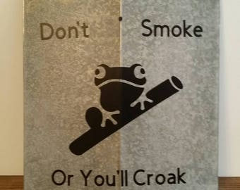 Don't smoke or you'll croak sign