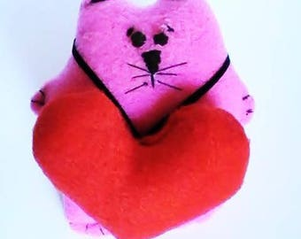 Pink cat with red plush heart
