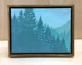 ONE OF A KIND Hand painted blue green forest landscape in a medium brown hand crafted floating wood frame