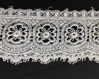 White lace, polyester embroidered design, 5.5 cm wide. Wh051