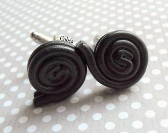 "Cuff links ""licorice rolls"""