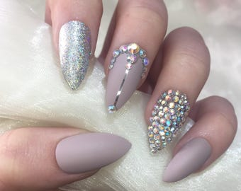 Matte nude and silver holographic stiletto false nails with rhinestone design