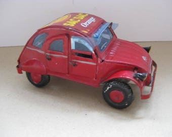 """Hand made red tin French """"Deux Chevaux"""" car."""