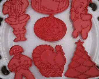 Vintage Set of 7 Red Tupperware Cookie Cutters Plastic with Handles.