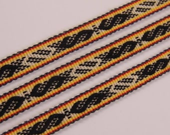 Ribbon, hand woven with ancient symbols. Colours - light orange, black, red, white.