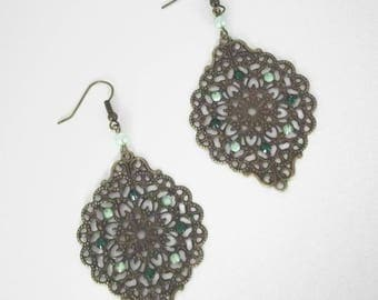 Green earrings with a stamp and rhinestone earrings