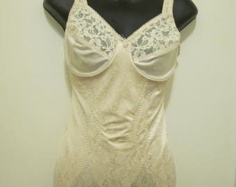 Vintage full body beige body suit corset with hook and eye crotch close. Adonna size 36 C.