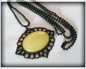 Long black ball chain _ Yellow cat's eye