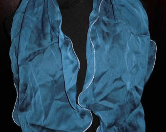 Blue shawl 100% silk lined silver wear on the shoulders or tie wire.