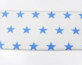 Fabric Jersey shining blue stars on white | Per Metre