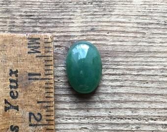 Moss green jadeite A jade oval cabochon 3.35ct