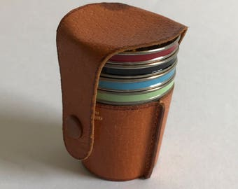 A Set of Vintage Metal Travel Shot Glasses in a Leather Case
