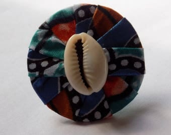 Round ring adjustable wax/Ankara and a cowrie