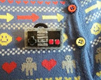 NES controller brooch.