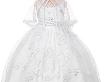Spaghetti strap baptism dress with Virgin Mary embroidered on the skirtThe waist line and the spaghetti strap are embellished with rhineston