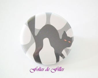 Orange red eyes black cat badge
