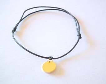 Black thin bracelet and a hammered antique gold