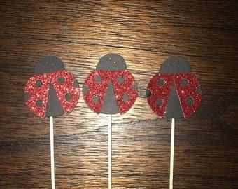 12 ladybug cupcake toppers.