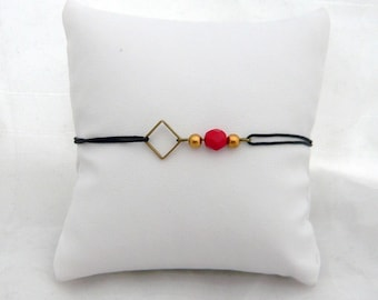 square bracelet and Red bead