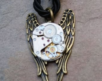 bronze wing watch movement pendant