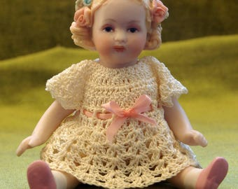 All Bisque China Doll with flowers in her hair