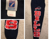 Vintage Buffalo Bills sweatpants // logo 7 vintage 90s // bills spell out // nfl football // adult size small // made in usa // retro