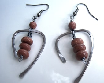 Earrings with hammered wire and Sunstone