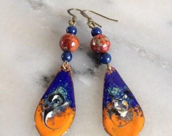 Dangling earrings, lapis blue and orange, copper enamel and Czech glass.