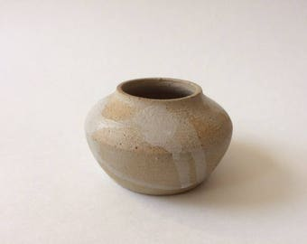 small whitewashed stoneware vase