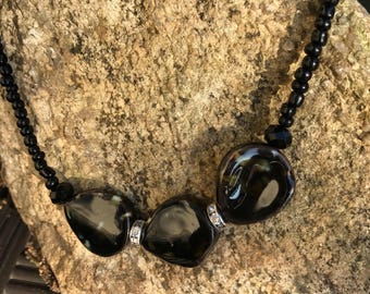 "Black Choker Necklace 3, 16"" to 18""."