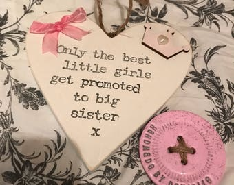 Only the best little girls get promoted to big sister hanging heart