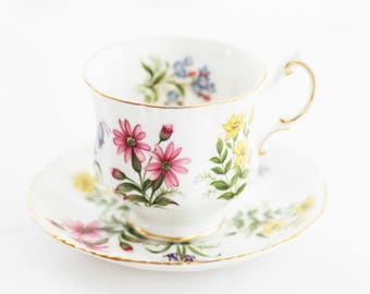 PARAGON by appointment to Her Majesty small teacup and saucer,wild flowers , goldgilt rims and foot, 1970