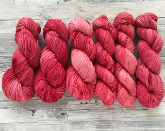 ROSEHIPS ARE RED - handdyed yarn - tonal red with a little bit of red speckles