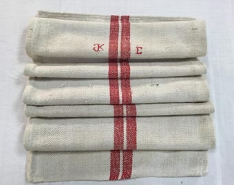 Vintage monogramed hemp-cotton feed grain sack with red stripes. Antique hemp grain bag, encrypted.