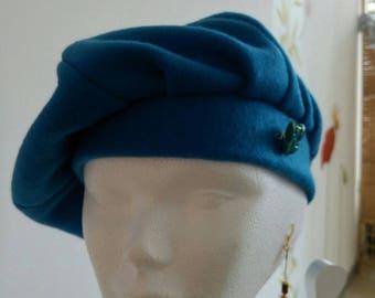 Royal blue beret adorned wax d bee brooch