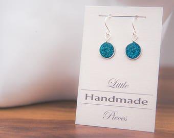 Earrings hanging silver wire wrapped beaten costume jewelery petrol blue gel glittery ornament
