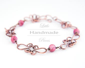 Solid Copper bracelet antiqued wire wrapped hammered pink pearls