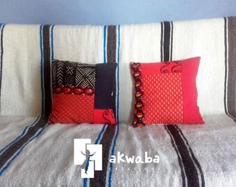 Pair of cushions in wax and red fabric from provence