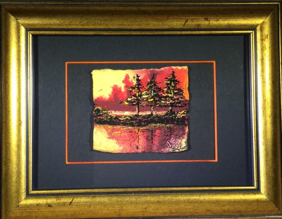 Small framed landscape painting in orange, yellow and black