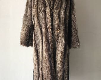 Raccoon fur coat woman size medium.