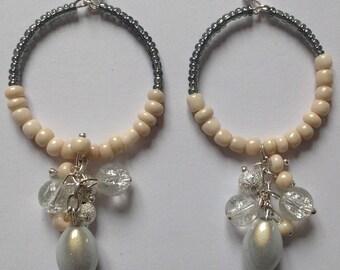 Dangle hoop earrings.