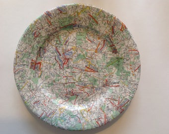 Plate decorated with maps of geography.