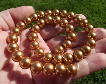 4 SHELL ROUND 10 MM GOLDEN SOUTH SEA PEARLS.