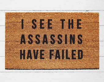 I See the Assassins Have Failed Doormat | Welcome Mat | Outdoor Rug |  Funny Doormat | Funny Welcome Mat