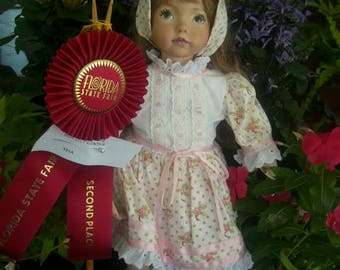 Rita Margaret has been juried and came in 2nd place in the FL state fair in 2016.  A porcelain doll, hand made from a Dianna Effner mold.