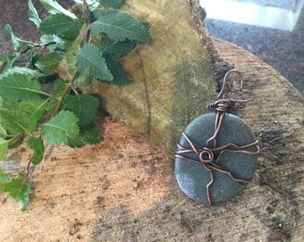 Copper pebble pendant.