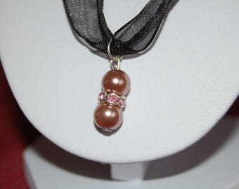 pretty ornament made from glass Pearl and Pink Rhinestone spacer rondelle beads